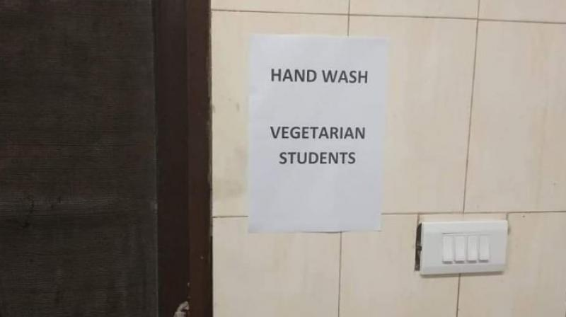 A student said posters had been put up near two entrances of north Indian mess located on second floor of Himalaya Mess Complex, specifying separate entry points and wash basins for non-vegetarian and vegetarian students. (Photo: Twitter | @ChintaBAR)