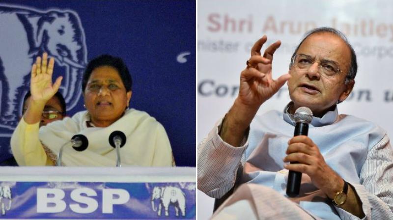 BSP supremo Mayawati and Finance Minister Arun Jaitley. (Photos: PTI)