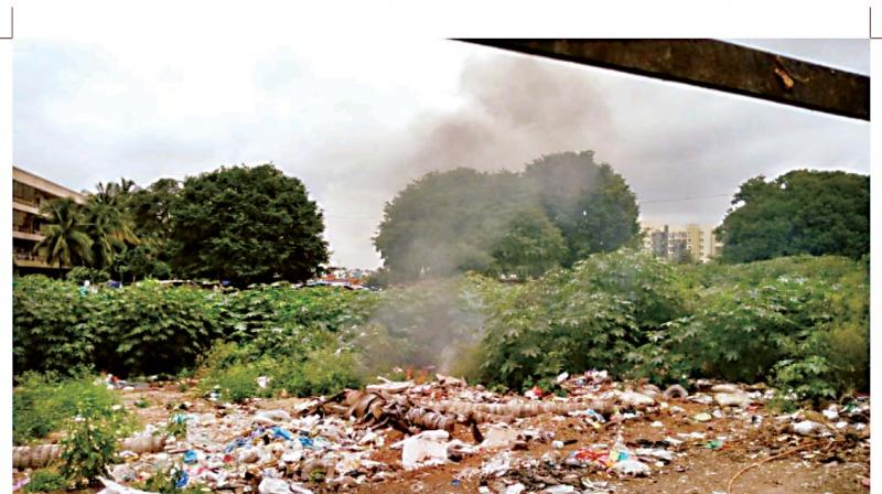 Garbage being burnt at Yelachenahalli.