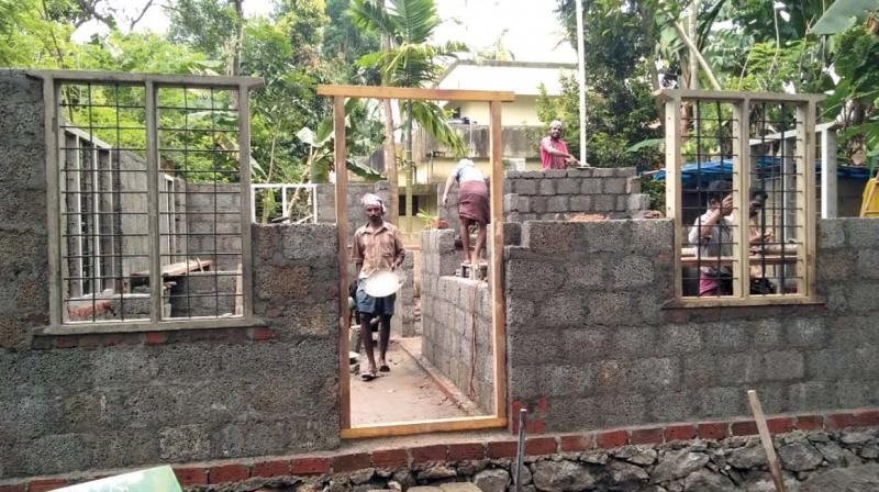A nodal institution has to be established as a delivery system for single window back-up services for affordable housing in each district. (In Pic): A house under construction for a flood victim in Ernakulam district.