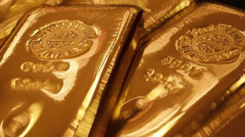 Analysts said trimming of positions by traders partly weighed on gold demands. (Photo: PTI)