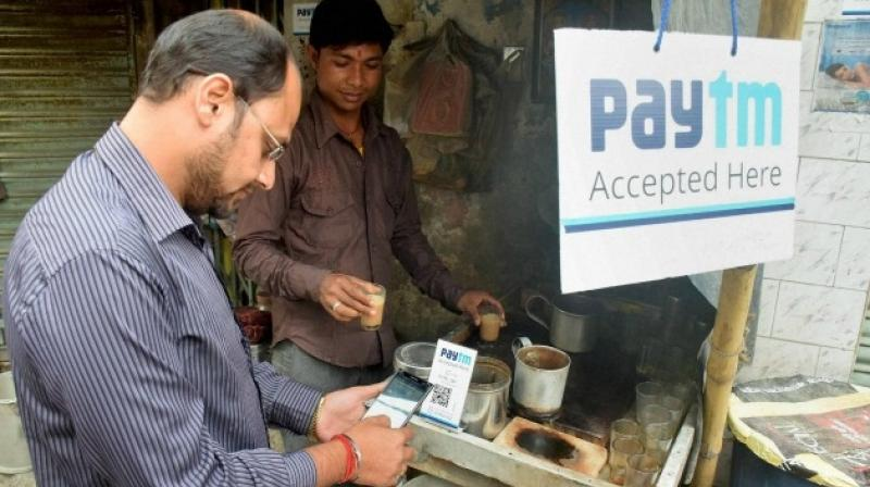 Paytm is likely to acquire two startups called Nearbuy and Little for around USD 30 million, said media reports. (Photo: PTI)