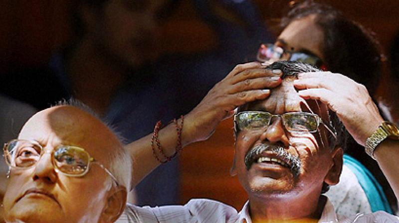 Investors look at changing share prices at BSE. On Wednesday, Nifty shed early losses. (Photo: PTI)