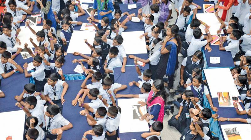 Around 1,000 children from various schools from in and around Coimbatore create a new Guinness World Record & Asian Book of Records - Ennangalilum, Vannangalilum Kalam for the most number of persons to colour simultaneously on Saturday.Image; DC