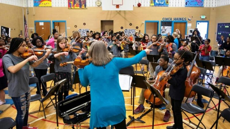 Some of the OrchKids students have studied at the prestigious summer camp at the Interlochen Centre for the Arts in Michigan. (Photo: AFP)