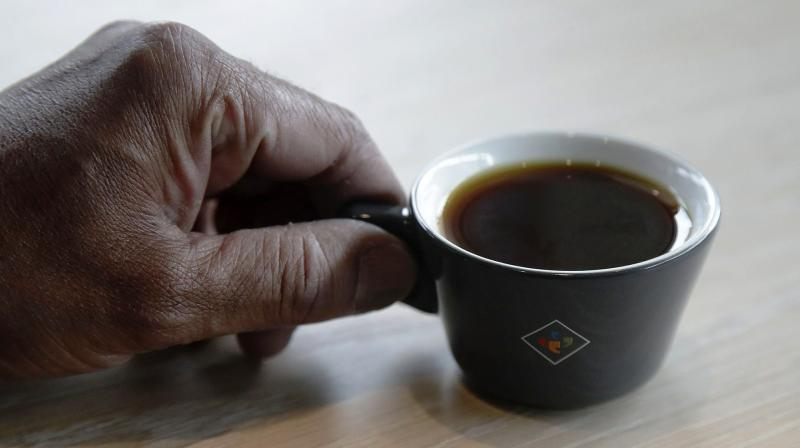 The coffee's high quality and limited supply set off a bidding war that determined its astronomical price, topping last year's winning beans that sold for $601 per pound. (Photo: AP)