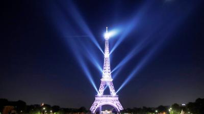 The Eiffel Tower is one of the most-visited tourist destinations in the world. (Photo: AP/Christophe Ena)