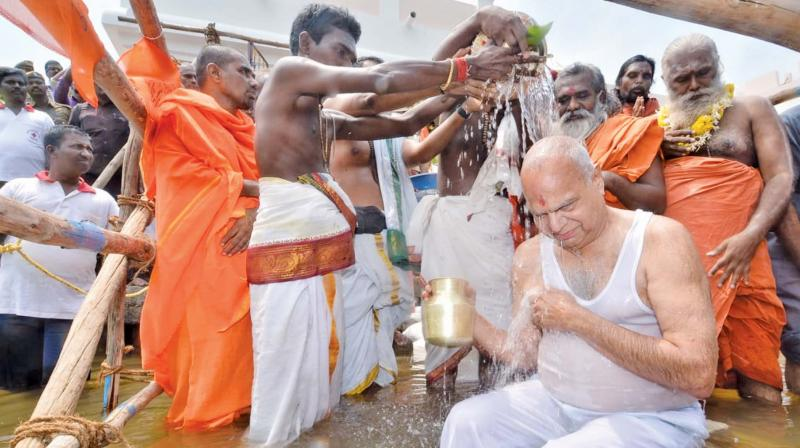 Governor Banwarilal Purohit who inaugurated the Tamirabharani Maha Pushkaram in Tirunelveli district on Thursday, takes a holy dip in the river.  	—DC