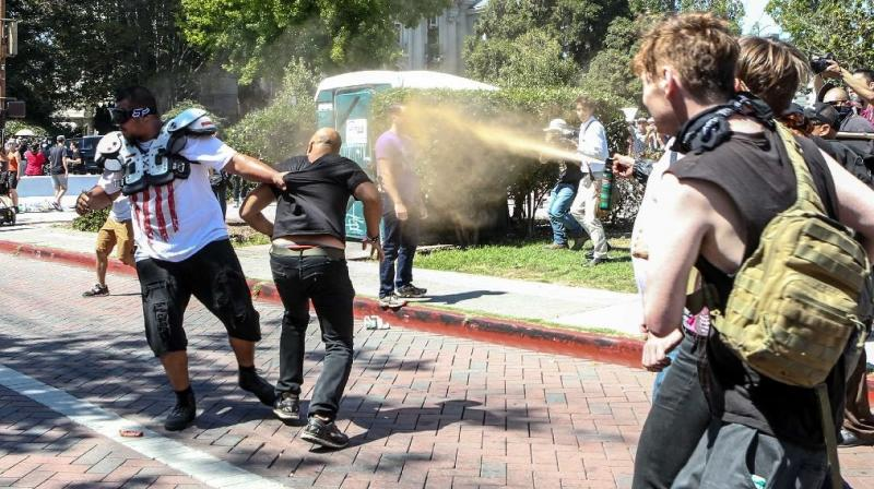 Joey Gibson (black t-shirt), leader of the alt-right Patriot Prayer group, gets pepper sprayed by leftist counter demonstrators in Berkeley, California. (Photo: AFP)