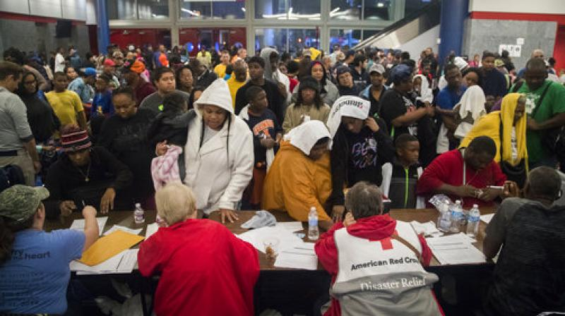 Thousands take shelter from the Tropical Storm Harvey at the George R. Brown Convention Center in Houston. (Photo: AP)