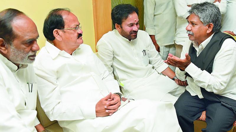 d9ed4e6558d5 Union minister M. Venkaiah Naidu listens to MRPS chief Manda Krishna Madiga  as TS BJP