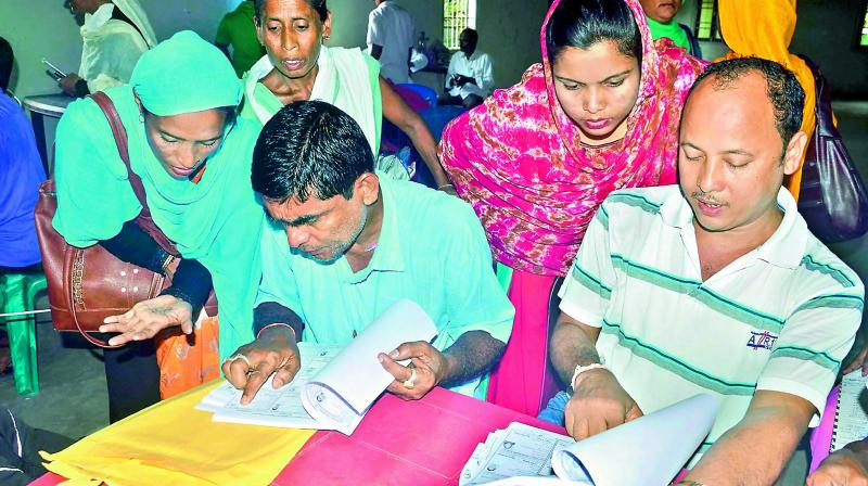 People check their names on the National Register of Citizens final list at an NRC centre in Buraburi Gaon, Morigaon in Assam. (Photo: PTI)