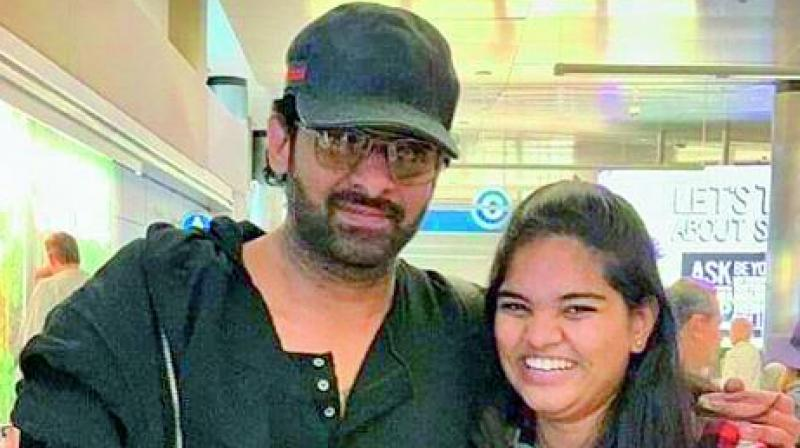 Soon after taking the picture with Prabhas, the overjoyed fan who just wanted to touch his cheek, lightly slapped him instead. But Prabhas didn't react, just walked away