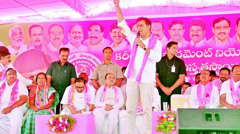 TRS party working president K.T. Rama Rao addresses the MP elections campaign programme at SRR College grounds in Karimnagar on Wednesday. — DC