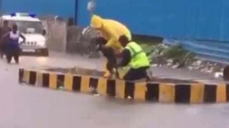 Mumbai Police officer rescues dog from flood water; watch video