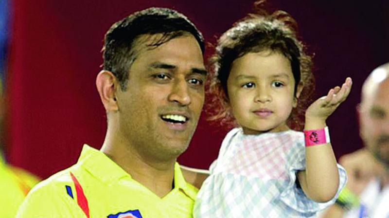 CSK skipper M.S. Dhoni with his daughter Ziva at the post-match ceremony in Mohali on Sunday. (Photo: BCCI)