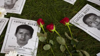 Red roses are placed on an altar in memorial for the missing students of Ayotzinapa, demanding justice on the 5th anniversary of their disappearance, in Guatemala City, Thursday, September 26, 2019. Family members continue to call for justice five years after the Ayotzinapa students were allegedly taken from buses by local police and turned over to a drug gang. (Photo: AP)