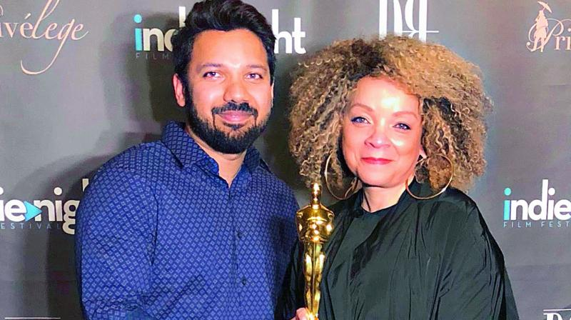 Raj Rohit Reddy with Ruth E. Carter