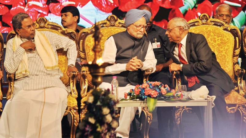 (From Left) Chief Minister Siddaramaiah, former Prime Minister Dr Manmohan Singh, former Governor  RBI Dr C Rangarajan at Dr BR Ambedkar School of Economics at Ambedkar Bhavan in Bengaluru on Wednesday (Photo: Shashidhar B)