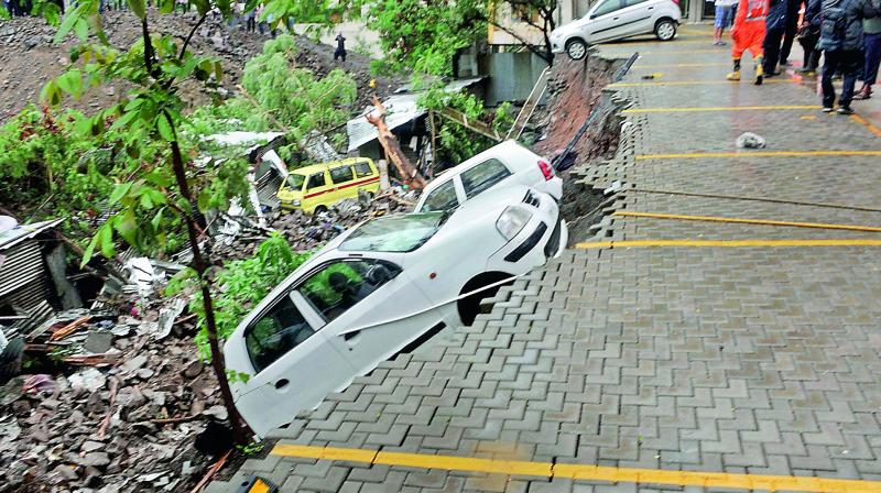 Vipul Agarwal and Vivek Agarwal, the developers and partners in Alcon Landmarks, were arrested on Saturday after a portion of a 22-ft-high compound wall of a housing society collapsed on adjoining shanties of construction workers following incessant rainfall. (Photo: File I PTI)