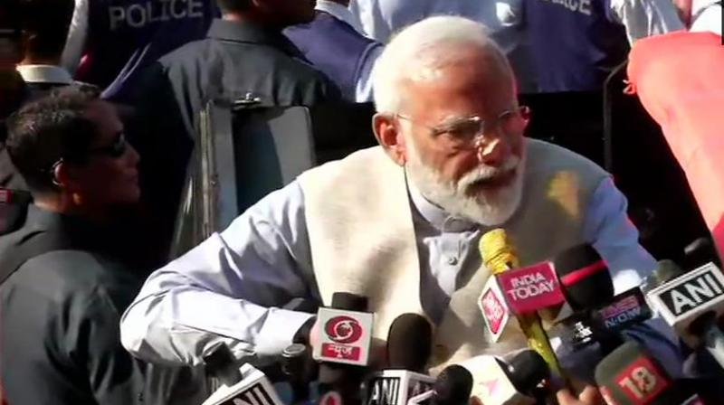 After casting his vote, Modi walked some distance from the polling booth and later had a brief interaction with media persons. (Photo: ANI | Twitter)
