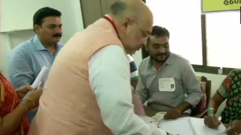 After casting his vote at the booth located in Naranpura area of Ahmedabad city, which comes under the Gandhinagar Lok Sabha constituency, he appealed to people to come out in large numbers to exercise their democratic right. (Photo: ANI | Twitter)