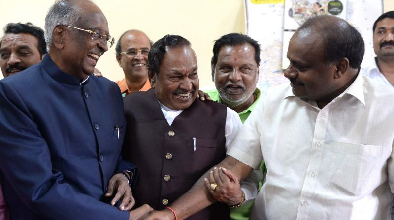 Council chairman D. H. Shankaramurthy being greeted by JD(S) state chief H.D. Kumaraswamy after winning the trust vote.