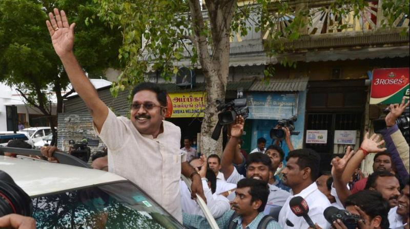 A beaming Dhinakaran told reporters in Madurai, 'We are the true AIADMK...people of RK Nagar have elected Amma's successor.' (Photo: PTI)