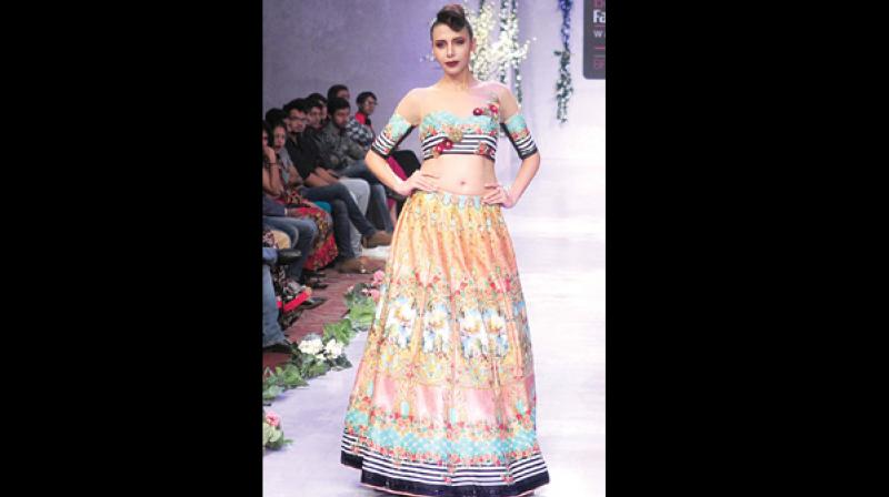 The model seen sporting a floral lehenga.