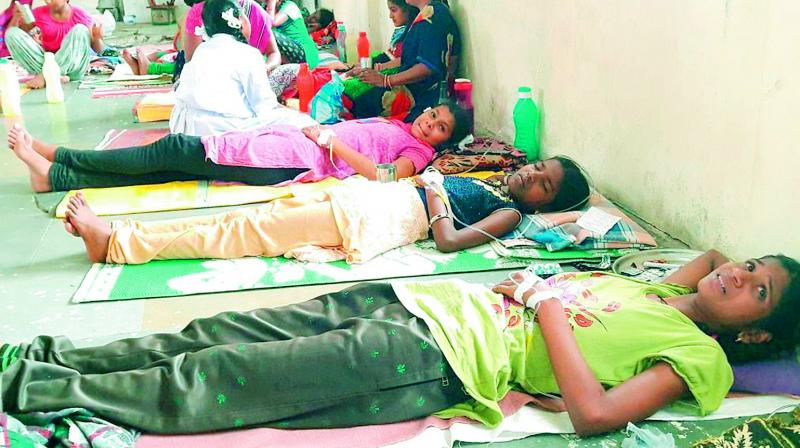 Students of the government-run residential hostel being treated for alleged food poisoning at a primary health care centre in Yadadri on Saturday. (Photo: DC)