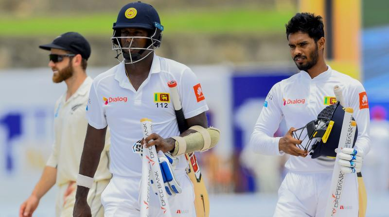 After stitching a 161-run first-wicket partnership with skipper Dimuth Karunaratne, Lahiru Thirimanne (64) was caught in front of the wickets by William Somerville. (Photo: AFP)