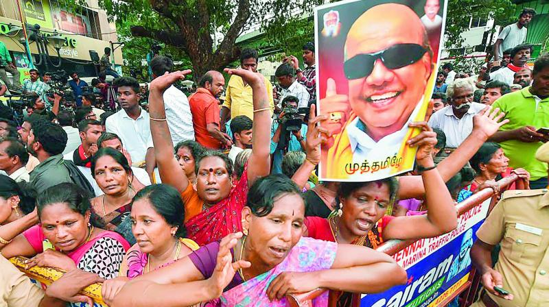 DMK supporters at Kauvery Hospital react after they hear the news of DMK president M. Karunanidhi's demise. (Photo: PTI)