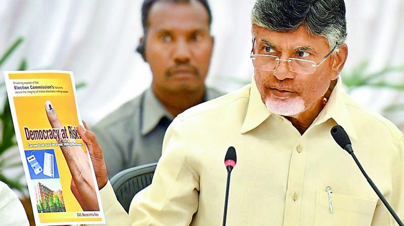 Chief Minister N. Chandrababu Naidu addresses the media conference and shows the Democracy at Risk book by G.V.L. Narasimha Rao, at Praja Vedika on Monday.  (DC)