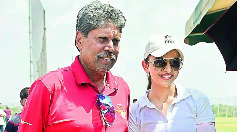 Former cricketer Kapil Dev with actress Rakul Preet Singh.