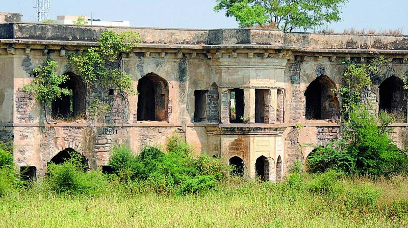 The Mian Mishq Mahal at Attapur lies in severe neglect  as the surrounding vegetation takes over its walls.