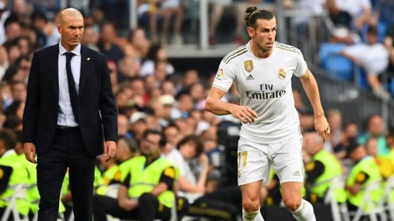 Gareth Bale scored twice to save Real Madrid from a damaging defeat away at Villarreal on Sunday before capping a dramatic 2-2 draw by being sent off in injury-time.  (Photo:AFP)