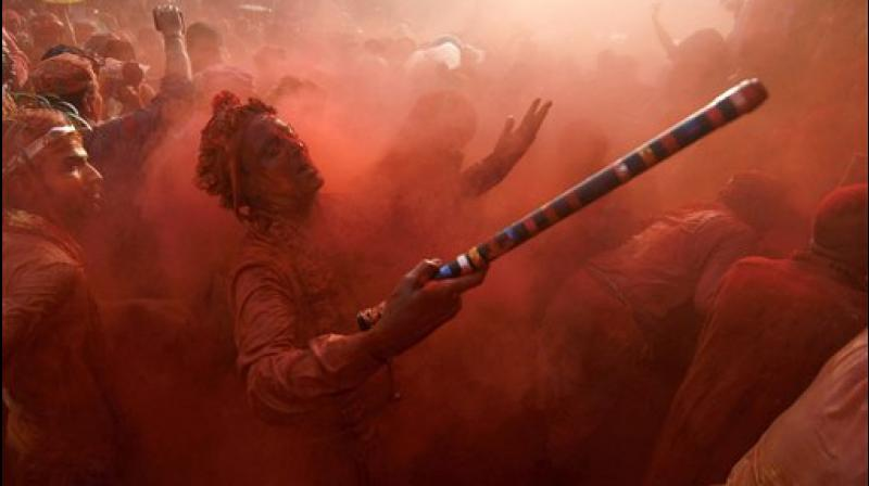 The festival of colours is celebrated all across India with much pomp and splendour. People across India are making last minute purchases to make the festival of colours a memorable one, while others are already in festive mood. (Photos: AP/ PTI)