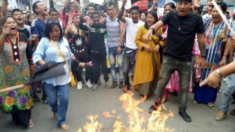 Gorkha Janmukti Morcha (GJM) supporters during their protest in Darjeeling on Thursday. (Photo: PTI)