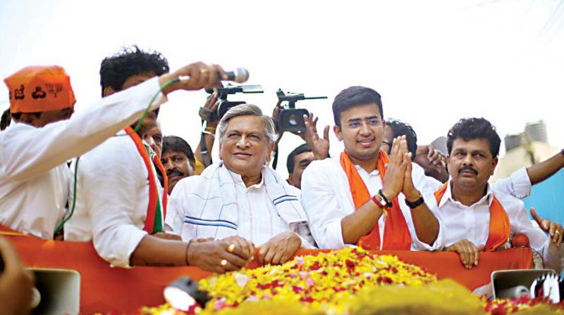 BJP candidate Tejasvi Surya campains with former CM S.M. Krishna on Friday