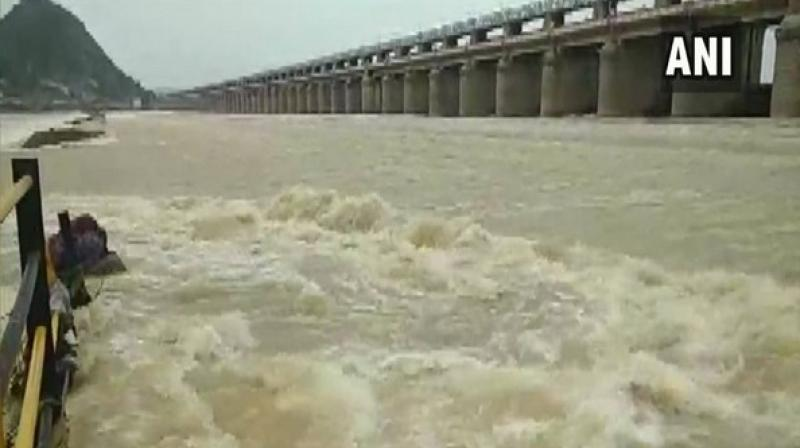 The barrage is receiving 4.5 lakh cusecs from the Pulichintala project and 70 gates of the barrage have been lifted for six feet height to release 4.5 lakh cusecs of water into the sea. (Photo: ANI)