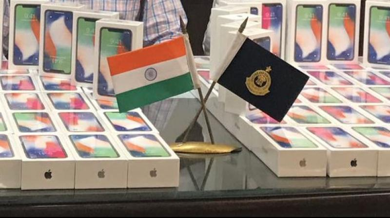 Man held at Delhi airport with 100 iPhone X handsets