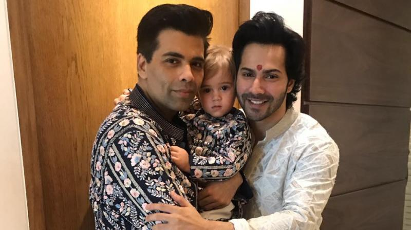 Varun Dhawan, Karan Johar and Yash Johar during Diwali celebrations.