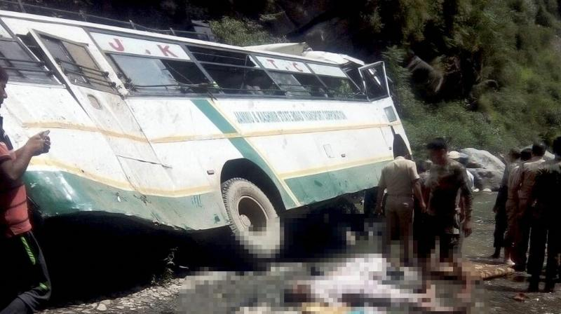 Security personnel carry out rescue work after a bus carrying Amarnath pilgrims falls into a gorge off Jammu-Srinagar National Highway in Ramban district on Sunday. (Photo: PTI)