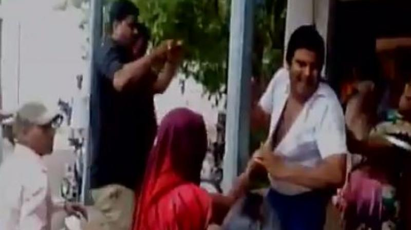 A lawyer in Madhya Pradesh's Guna was beaten up by a group of women for allegedly making sexual advances towards women. (Photo: Videograb)