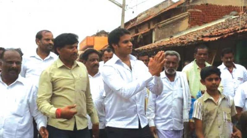 A file photo of state JD(S) president H.D. Kumaraswamy's actor son Nikhil Gowda campaigning for party candidate in Ramanagara