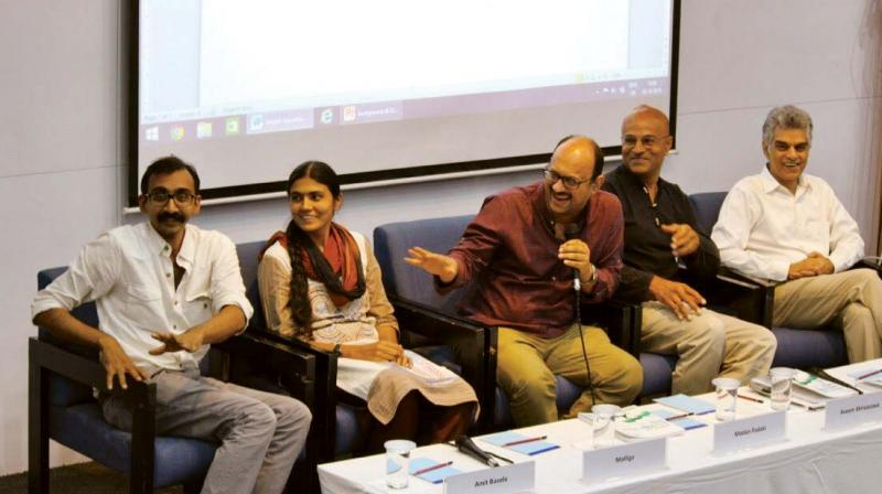 (From left) Amit Basole, Head Centre for Sustainable Employment, Mallige, Youth for Employment, Madan Padaki, Founder & CEO, Bridge (Moderator), Aseem Shrivatsava, Writer & Economist, Mahesh Vyas, Centre of Monitoring, The Indian Economy at a panel discussion in Bengaluru on Monday