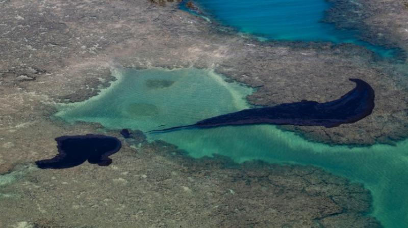 Officials say it not yet possible to quantify the environmental and economic damage from the oil slicks. (Photo: AFP)