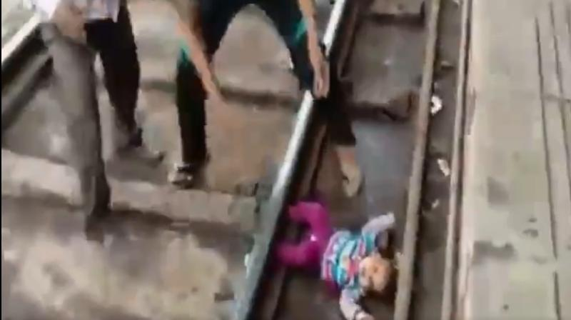 In the 30-second video clip, the infant, who can be seen crying, was rescued safely and handed over to the parents. (Photo: ANI/Twitter)