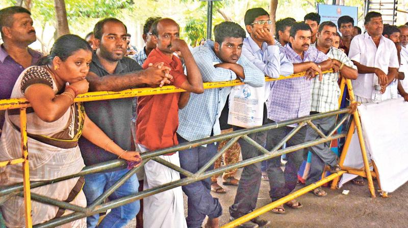Parents eagerly wait for their wards to return after counselling in College of Engineering, Guindy, on Monday (Photo: DC)