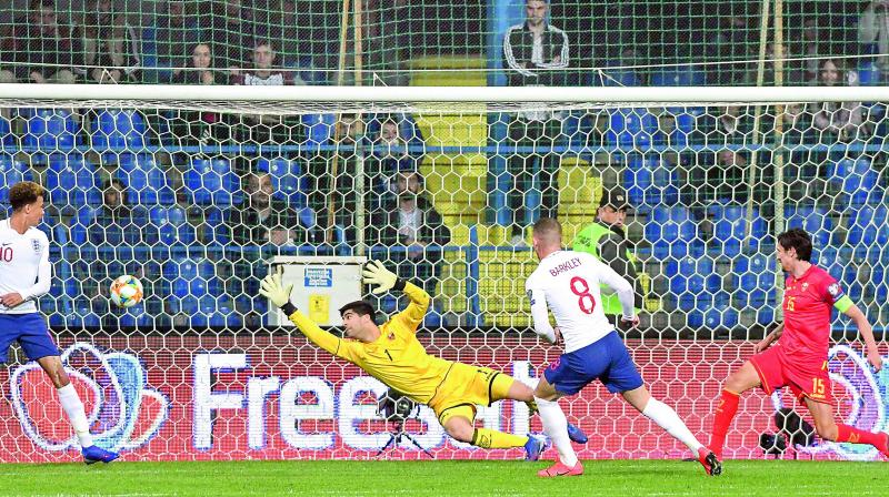 England midfielder Ross Barkley (second from right) scores a goal during the Euro 2020 qualifier against Montenegro at Podgorica City Stadium in Montenegro. England won 5-1.(Photo: AFP)